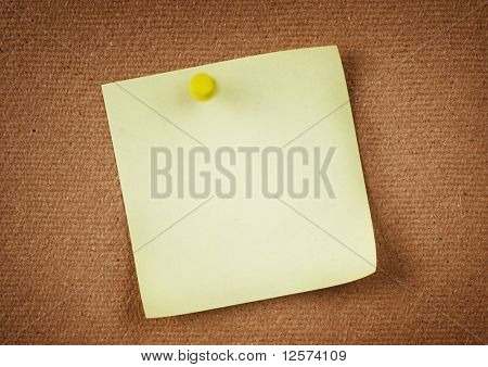 Note paper with push pins on notice board