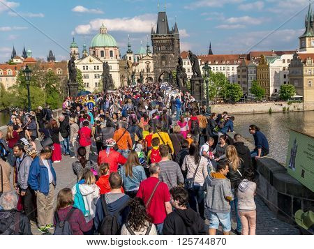 PRAGUE, CZECH REPUBLIC - MAY 02, 2015: Charles Bridge full of tourists, Prague, Czech Republic
