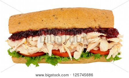 Chicken and salad sandwich with cranberry jelly in a crusty bread stick isolated on a white background