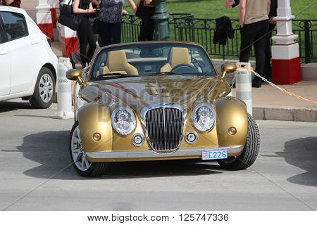 Monte-Carlo Monaco - April 6 2016: Golden Mitsuoka Roadster Parked in Front of the Monte-Carlo Casino in Monaco