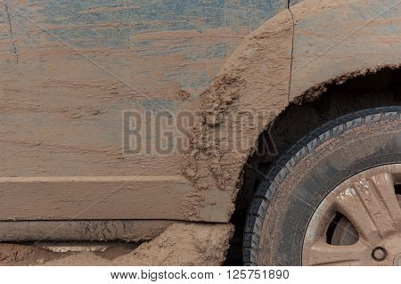Close up of dirty wheel - off road vehicle with mud
