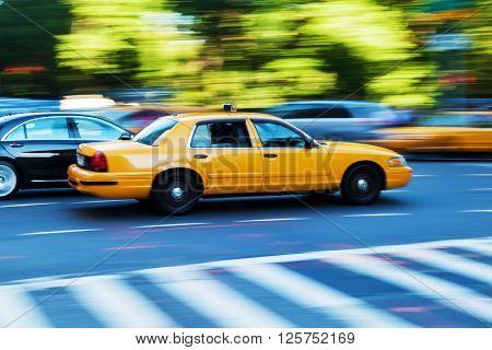 yellow cab of Manhattan New York City in motion blur