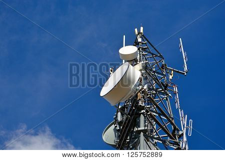 Cell Tower With Microwave Dishes At A Low Angle