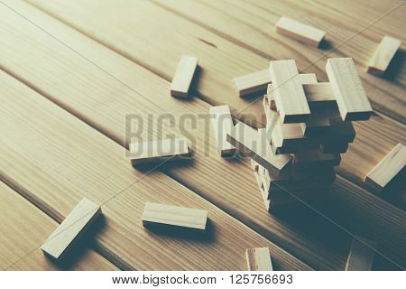 Jenga Wood blocks stack game on wood background