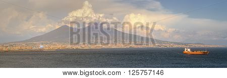 Napoli and mount Vesuvius in the background at sunset in a summer day, Italy, Campania