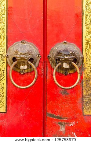 close-up of chinese door decorate with lion statue