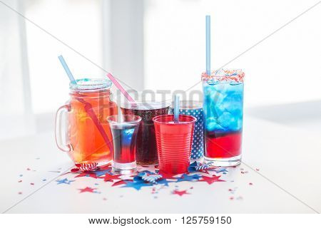 american independence day, celebration, patriotism and holidays concept - close up of cups and glasses with drinks on american independence day party