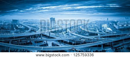 panoramic view of interchange overpass bridge in nanjing blue tone