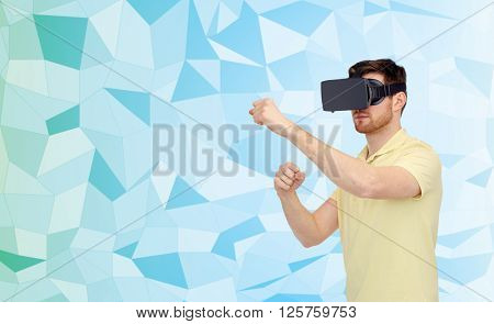 3d technology, virtual reality, entertainment and people concept - young man with virtual reality headset or 3d glasses playing game and fighting over low poly background