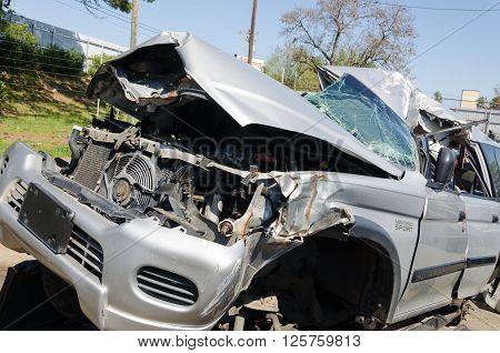 Charlotte, NC, United States - April 14, 2016: Damaged car close up on a junk yard