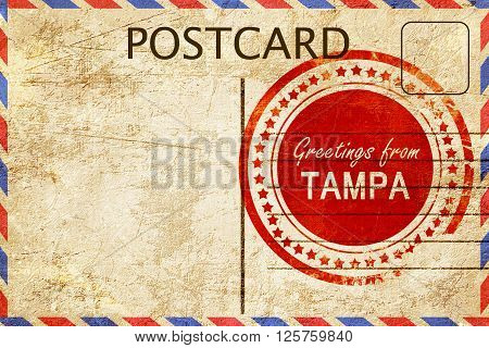greetings from tampa, stamped on a postcard