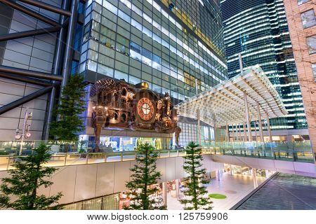 TOKYO, JAPAN - DECEMBER 22, 2015: The NTV Building's fantasy inspired Large Clock in the Shiodome District. The clock was designed by Hayao Miyazaki of Studio Ghibli.