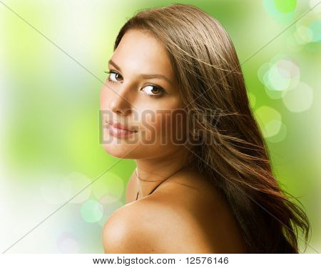 Beautiful Healthy Young Woman over nature background