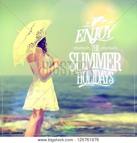 Enjoy the summer holidays quote card with girl in white dress with lacy umbrella on a sea beach