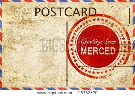 greetings from merced, stamped on a postcard