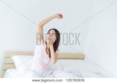 Woman yawning at morning