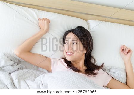 Woman lying down on bed