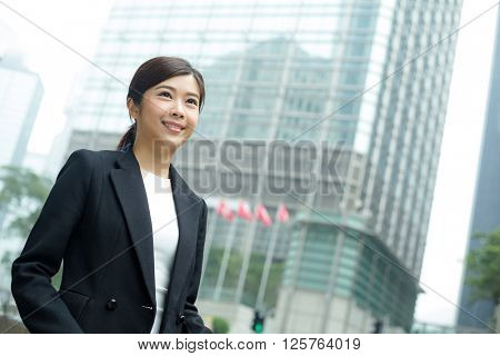 Young Businesswoman look far away