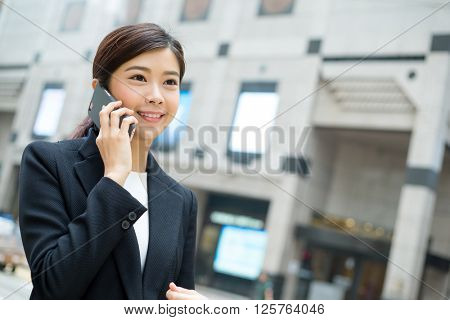 Business woman calling for someone