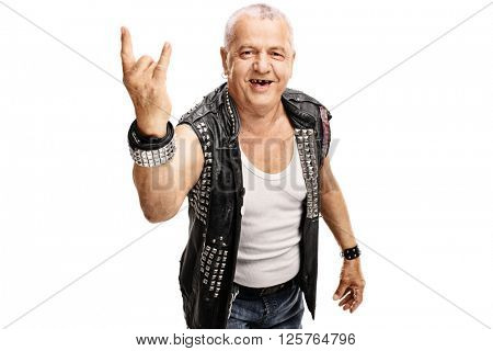 Senior punker in a black leather jacket with pins making a hardcore hand gesture isolated on white background