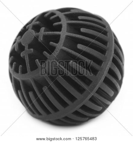 Closeup of black coloured bioball over white background