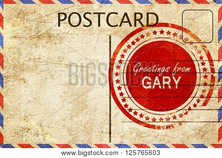 greetings from gary, stamped on a postcard