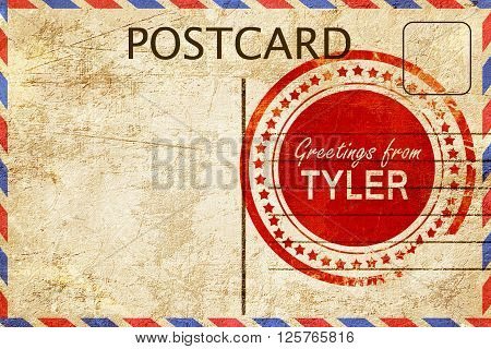 greetings from tyler, stamped on a postcard