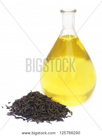Caraway seeds with essential oil in glass jar