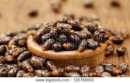 Close up of Castor beans in a wooden bowl