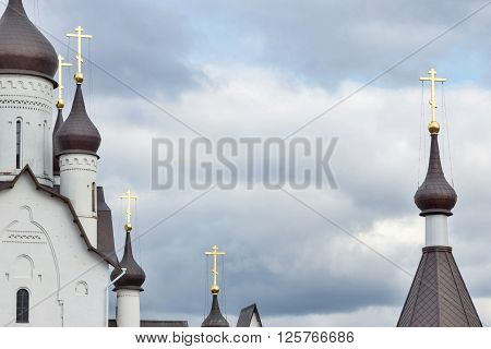 elements with domes and crosses of Christian orthodox church against a gloomy sky and a blank space for the text