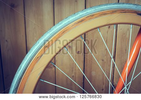 Fixed Gear Bicycle Parked With Wood Wall, Close Up Image Part Of Bicycle