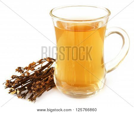 Ayurvedic medicinal Chirata with herbal juice over white background