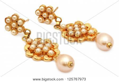Earrings made of gold and pearls over whte background