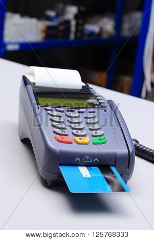 Payment terminal with credit card on desk in store credit card reader payment terminal finance concept