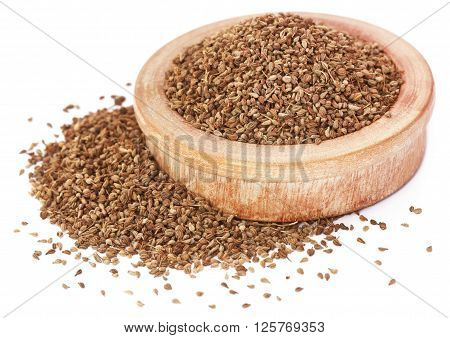 Close up of ajwain seeds in a wooden bowl