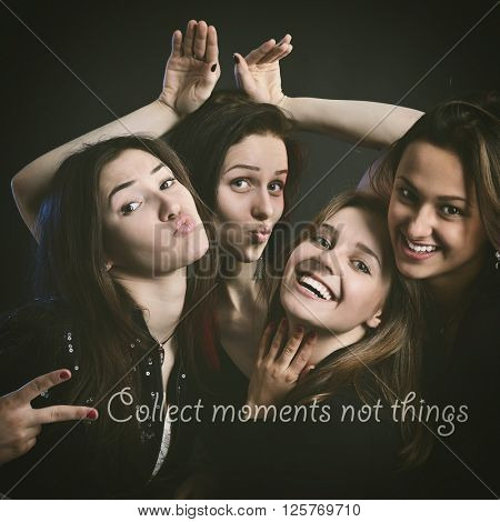 fashionable attractive happy party teen girls have fun with positive message, over black background