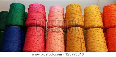 Colored Spools Of Thread And Balls Of Wool For Sale In The Shop For Tailors