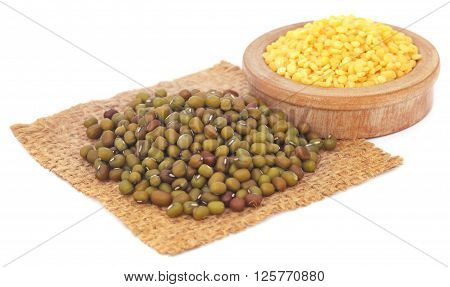 Mung bean in jute bag and bowl over white background