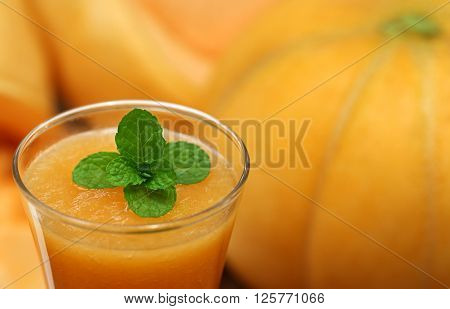 Cucumis Melo or Muskmelon juice with mint leaves