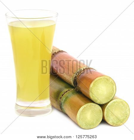 Juice with pieces of sugarcane over white background