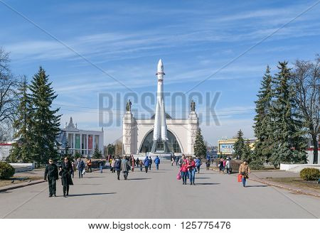 Moscow, Russia - March 29, 2016: People on the Main avenue of VDNH in front of model of rocket of Gagarin near the pavilion