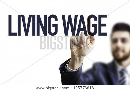 Business man pointing the text: Living Wage