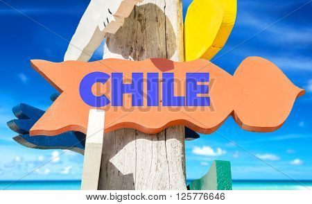 Chile signpost with beach background
