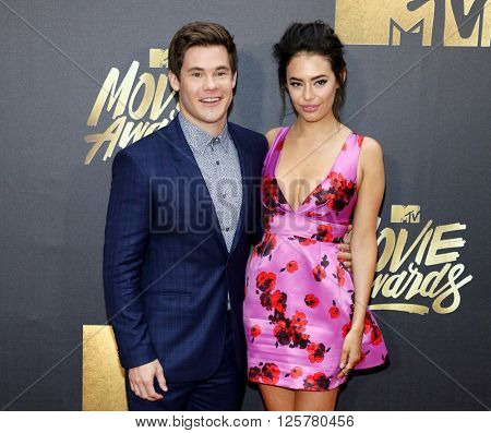 Adam DeVine and Chloe Bridges at the 2016 MTV Movie Awards held at the Warner Bros. Studios in Burbank, USA on April 9, 2016.