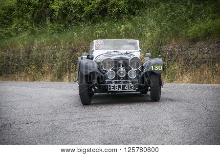 PESARO, ITALY - MAY 15: SS Jaguar 100 1937 on an old racing car in rally Mille Miglia 2015 the famous italian historical race (1927-1957) on May 2015