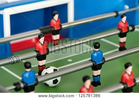 Close Up Of Figures And Ball In Foosball Table