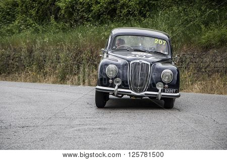 PESARO, ITALY - MAY 15: LANCIA Aurelia B21 Berlina 1951 on an old racing car in rally Mille Miglia 2015 the famous italian historical race (1927-1957) on May 2015