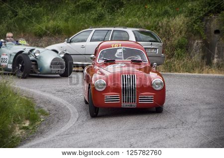 PESARO, ITALY - MAY 15: FIAT 1100 S 1948 on an old racing car in rally Mille Miglia 2015 the famous italian historical race (1927-1957) on May 15 2015