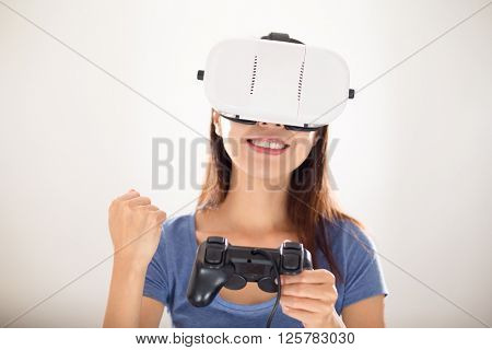 Woman play with video game though VR device