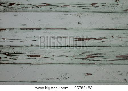 Side Of An Old White Barn, With Paint Chipped And Peeling.